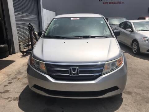 2013 Honda Odyssey for sale at America Auto Wholesale Inc in Miami FL