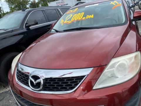 2010 Mazda CX-9 for sale at America Auto Wholesale Inc in Miami FL