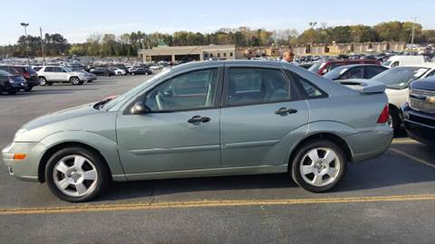 2005 Ford Focus for sale at WIGGLES AUTO SALES INC in Mableton GA