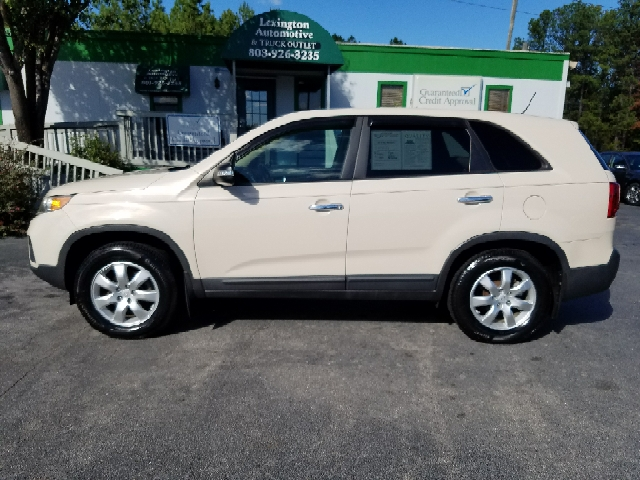 2011 KIA SORENTO BASE 4DR SUV beige 2-stage unlocking doors abs - 4-wheel airbag deactivation -