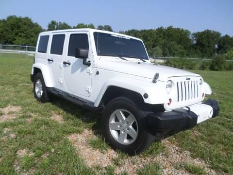 2012 Jeep Wrangler Unlimited for sale at Farmington Auto Plaza in Farmington MO