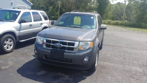 2011 Ford Escape for sale at Pool Auto Sales Inc in Spencerport NY