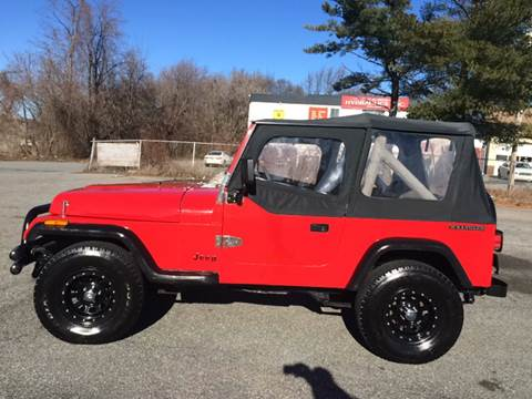 1989 Jeep Wrangler for sale at D'Ambroise Auto Sales in Lowell MA