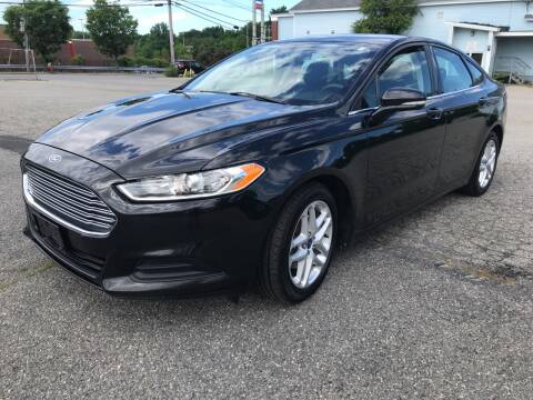 2013 Ford Fusion for sale at D'Ambroise Auto Sales in Lowell MA