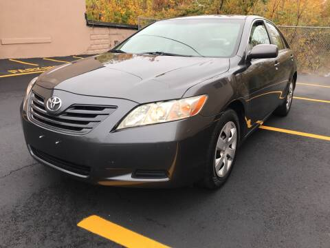 2009 Toyota Camry for sale at D'Ambroise Auto Sales in Lowell MA