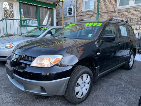 2005 Mitsubishi Outlander for sale at Barnes Auto Group in Chicago IL