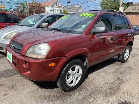 2005 Hyundai Tucson for sale at Barnes Auto Group in Chicago IL