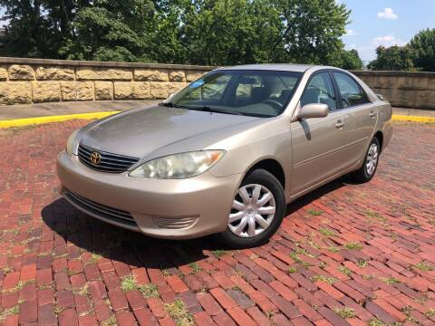 2005 Toyota Camry for sale at PUTNAM AUTO SALES INC in Marietta OH