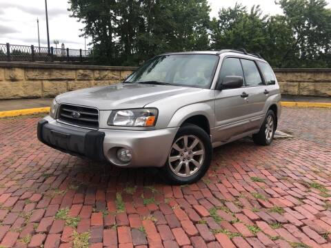 2005 Subaru Forester for sale at PUTNAM AUTO SALES INC in Marietta OH