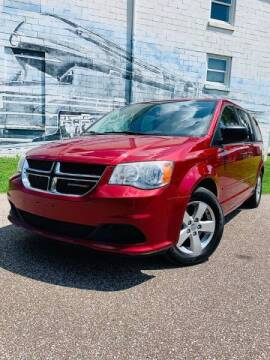 2014 Dodge Grand Caravan for sale at PUTNAM AUTO SALES INC in Marietta OH