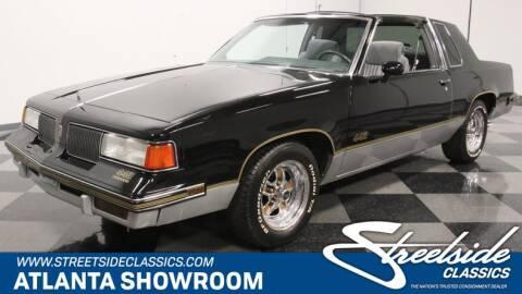 1987 Oldsmobile Cutlass Supreme for sale at Streetside Classics in Lithia Springs GA
