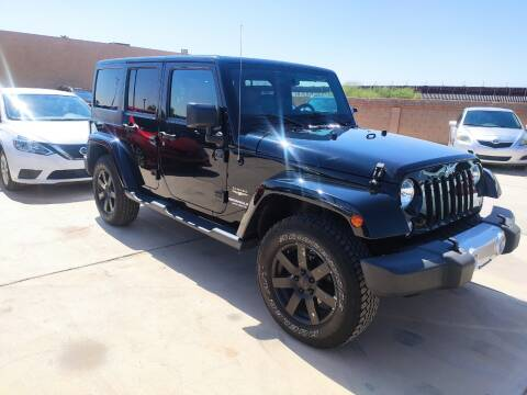 2015 Jeep Wrangler Unlimited for sale at A AND A AUTO SALES in Gadsden AZ