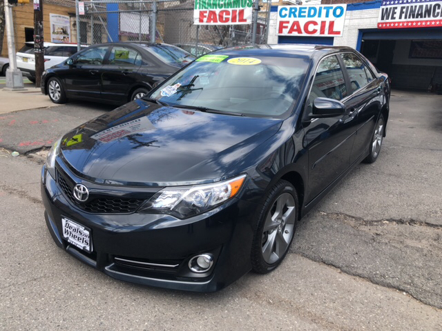 2014 Toyota Camry for sale at DEALS ON WHEELS in Newark NJ