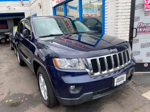 2012 Jeep Grand Cherokee for sale at DEALS ON WHEELS in Newark NJ