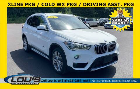 2017 BMW X1 for sale at LOU'S CAR CARE CENTER in Baldwinsville NY