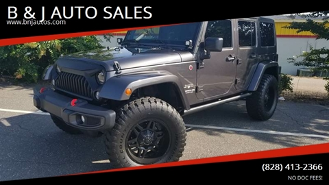 2016 Jeep Wrangler Unlimited for sale at B & J AUTO SALES in Morganton NC