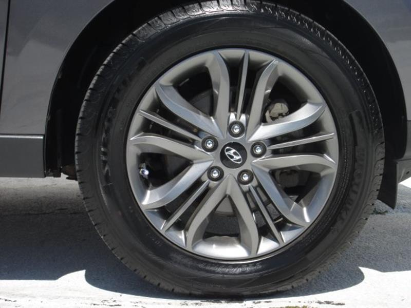 2014 Hyundai Tucson for sale at Rooster Bush Automotive in Lenoir NC