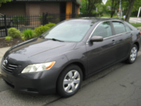 2009 Toyota Camry LE for sale at Top Choice Auto Inc in Massapequa Park NY