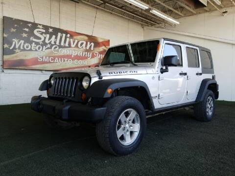 2012 Jeep Wrangler Unlimited for sale at SULLIVAN MOTOR COMPANY INC. in Mesa AZ
