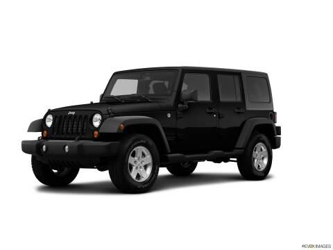 2013 Jeep Wrangler Unlimited for sale at SULLIVAN MOTOR COMPANY INC. in Mesa AZ