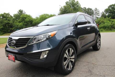 2011 Kia Sportage for sale at Oak City Motors in Garner NC