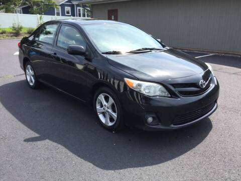 2012 Toyota Corolla for sale at International Motor Group LLC in Hasbrouck Heights NJ