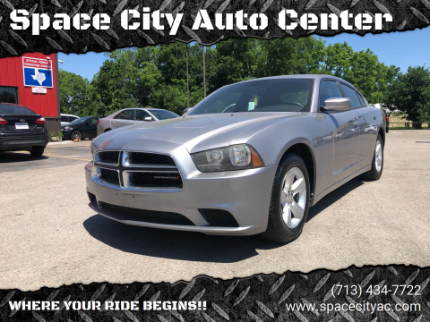 2014 Dodge Charger for sale at Space City Auto Center in Houston TX