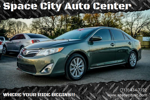 2014 Toyota Camry for sale at Space City Auto Center in Houston TX
