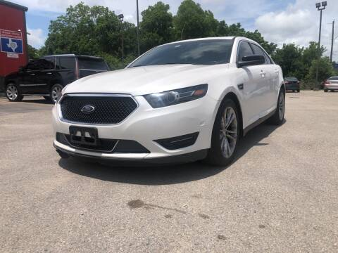 2013 Ford Taurus for sale at Space City Auto Center in Houston TX