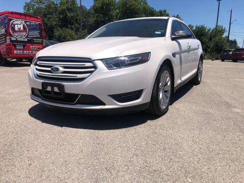 2015 Ford Taurus for sale at Space City Auto Center in Houston TX