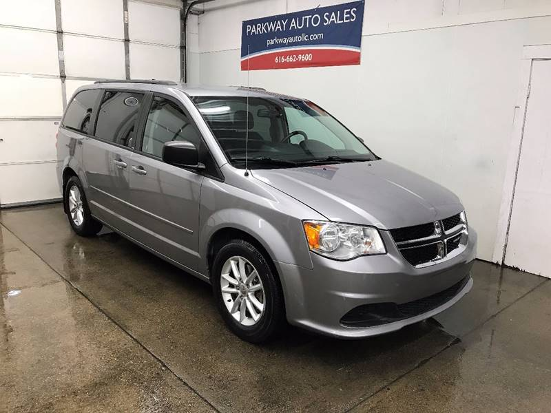 2013 Dodge Grand Caravan for sale at PARKWAY AUTO in Hudsonville MI