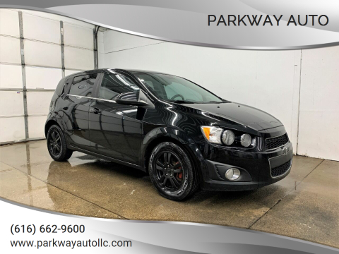 2012 Chevrolet Sonic LT for sale at PARKWAY AUTO in Hudsonville MI