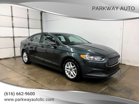 2015 Ford Fusion for sale at PARKWAY AUTO in Hudsonville MI