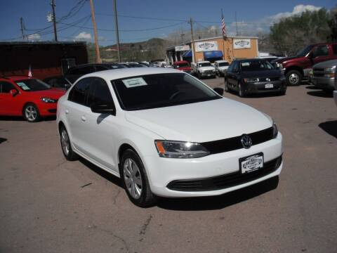 2014 Volkswagen Jetta for sale at BERKENKOTTER MOTORS in Brighton CO