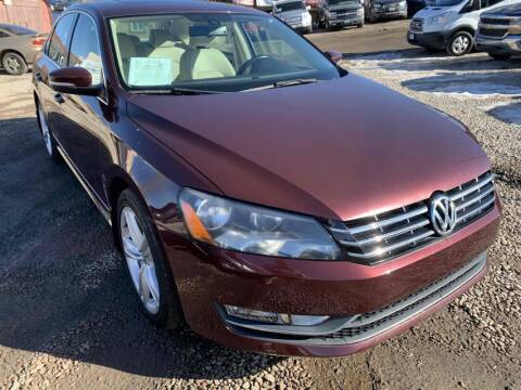 2014 Volkswagen Passat for sale at BERKENKOTTER MOTORS in Brighton CO