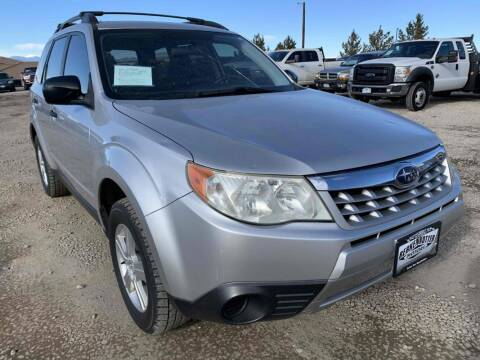2011 Subaru Forester for sale at BERKENKOTTER MOTORS in Brighton CO