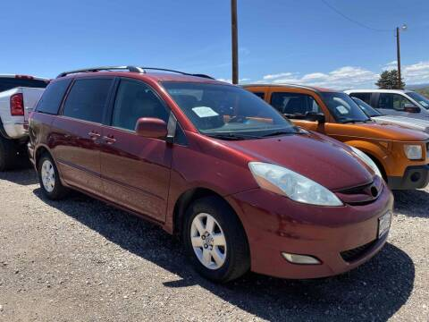 2006 Toyota Sienna for sale at BERKENKOTTER MOTORS in Brighton CO