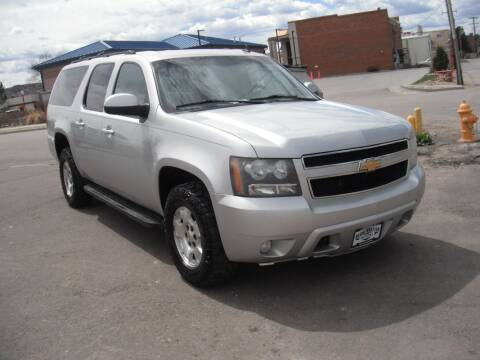 2011 Chevrolet Suburban for sale at BERKENKOTTER MOTORS in Brighton CO