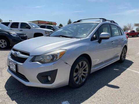 2012 Subaru Impreza for sale at BERKENKOTTER MOTORS in Brighton CO