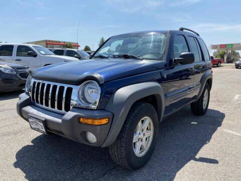 2004 Jeep Liberty for sale at BERKENKOTTER MOTORS in Brighton CO