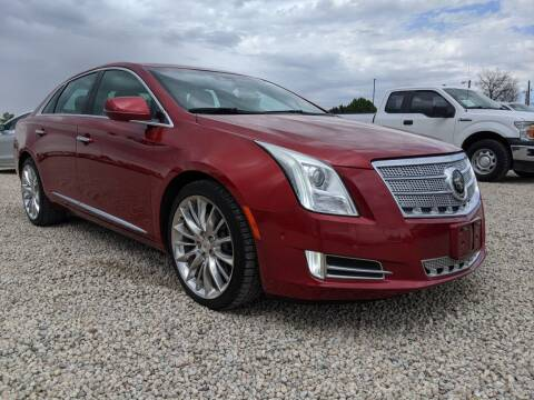 2014 Cadillac XTS for sale at BERKENKOTTER MOTORS in Brighton CO