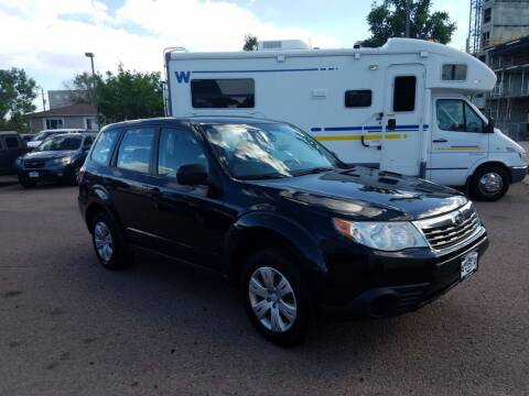 2009 Subaru Forester for sale at BERKENKOTTER MOTORS in Brighton CO