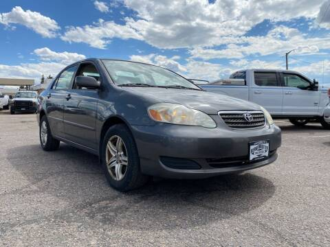 2007 Toyota Corolla for sale at BERKENKOTTER MOTORS in Brighton CO