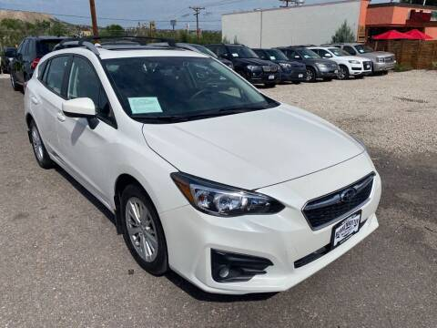 2018 Subaru Impreza for sale at BERKENKOTTER MOTORS in Brighton CO