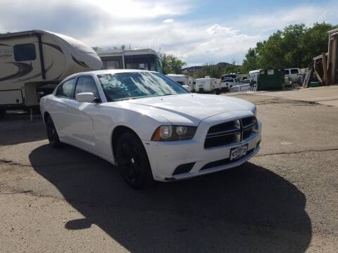 2011 Dodge Charger for sale at BERKENKOTTER MOTORS in Brighton CO