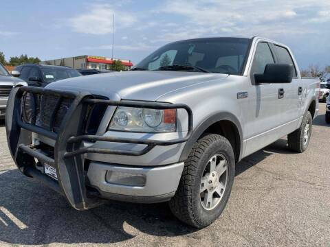 2004 Ford F-150 for sale at BERKENKOTTER MOTORS in Brighton CO