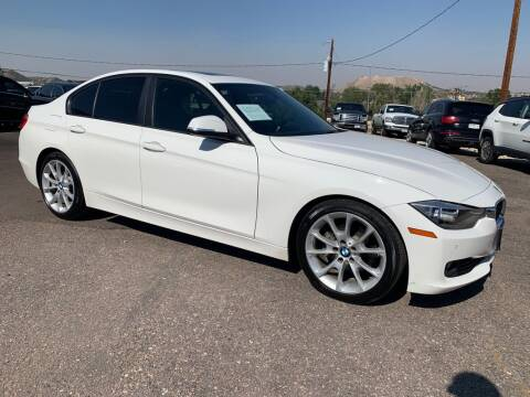 2014 BMW 3 Series for sale at BERKENKOTTER MOTORS in Brighton CO