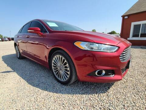 2013 Ford Fusion for sale at BERKENKOTTER MOTORS in Brighton CO