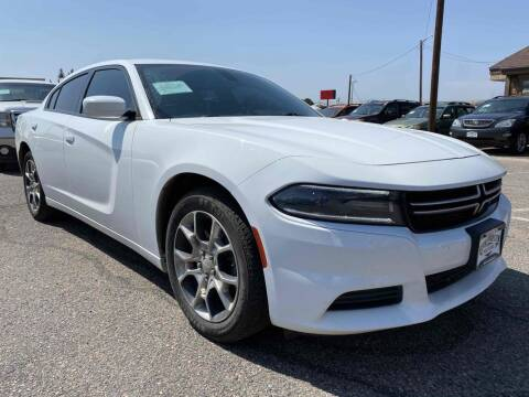 2016 Dodge Charger for sale at BERKENKOTTER MOTORS in Brighton CO