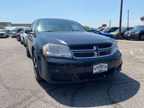 2012 Dodge Avenger for sale at BERKENKOTTER MOTORS in Brighton CO